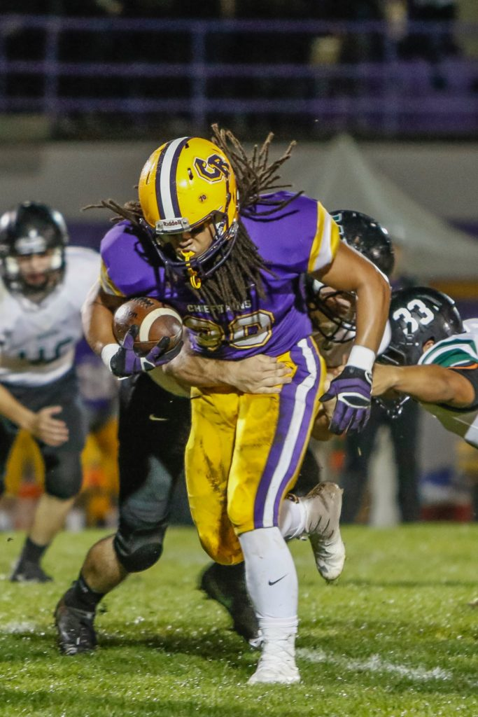 Columbia River running back Hunter Pearson (30) runs for a touchdown against Woodland Friday. Photo by Mike Schultz.