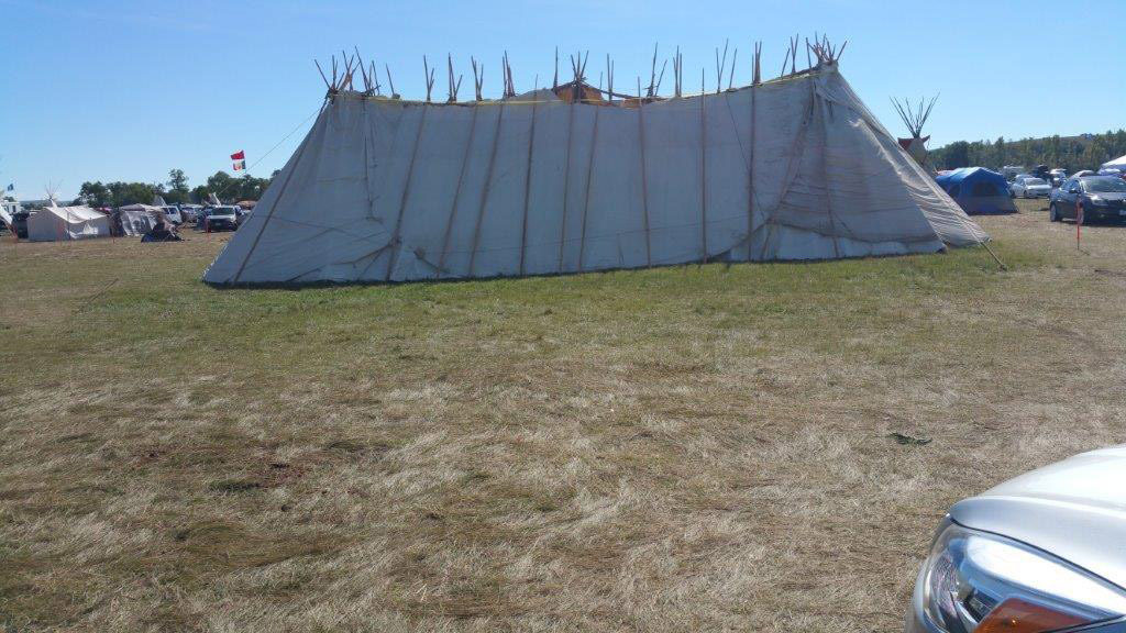 Inside this lodge, at the main camp of the Dakota Access Pipeline resistance, headed by the Standing Rock Sioux Tribe, the seven council fires of Sioux gathered for the first time in nearly 130 years. Photo courtesy of Melody Pfeifer, Cowlitz Indian Tribe