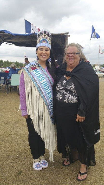 Melody Pfeifer (left), a member of the Cowlitz Indian Tribe, stands next to Miss Indian World, 2016-17, Danielle Ta'Sheena Finn, 25, a Lakota Sioux from Standing Rock, North Dakota, who is studying law, at the resistance for the Dakota Access Pipeline. Photo courtesy of Melody Pfeifer, Cowlitz Indian Tribe