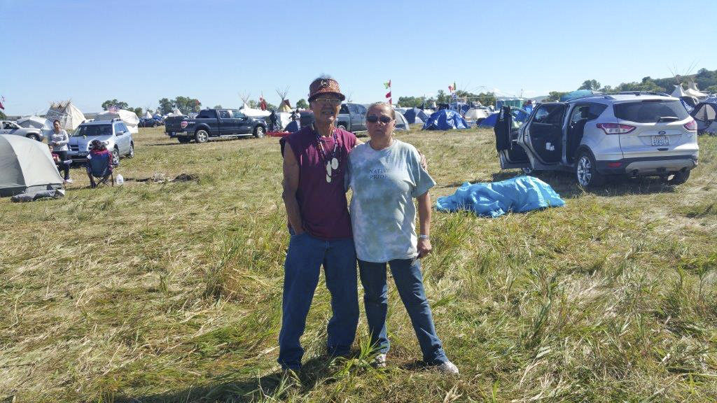 Linda O'Brien, a member of the Cherokee-Shawnee tribe and wife of Cowlitz Indian Tribe councilman John O'Brien (not pictured) stands with Joseph Komok, an Alaskan Inuit, at the resistance of the Dakota Access Pipeline in North Dakota, in early September. Photo courtesy of Melody Pfeifer, Cowlitz Indian Tribe