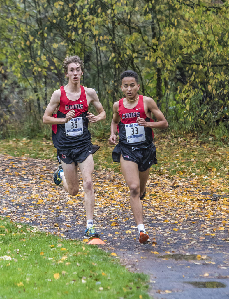 Led by the 1-2 finish of Yacine Guermali (33) and Daniel Maton (35), Camas claimed the Greater St. Helens League Class 4A boys cross country title at Lewisville Park Thursday. Photo by Mike Schultz