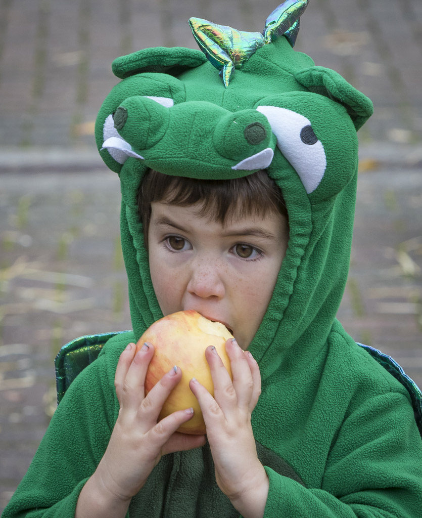 Eight-year-old Garrett Lees obviously feels an apple is an appropriate snack for a frog. Lees was one of many youngsters who donned their costumes for the annual Downtown Washougal Pumpkin Harvest Festival Wednesday. Photo by Mike Schultz