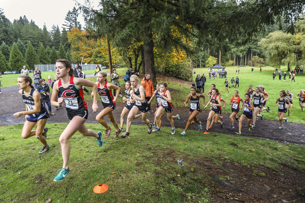 The Greater St. Helens League Class 4A cross country meet was held Thursday at Lewisville Park in Battle Ground. The Camas girls won their fifth consecutive GSHL title and will now see their fifth state championship in the last six years. Photo by Mike Schultz