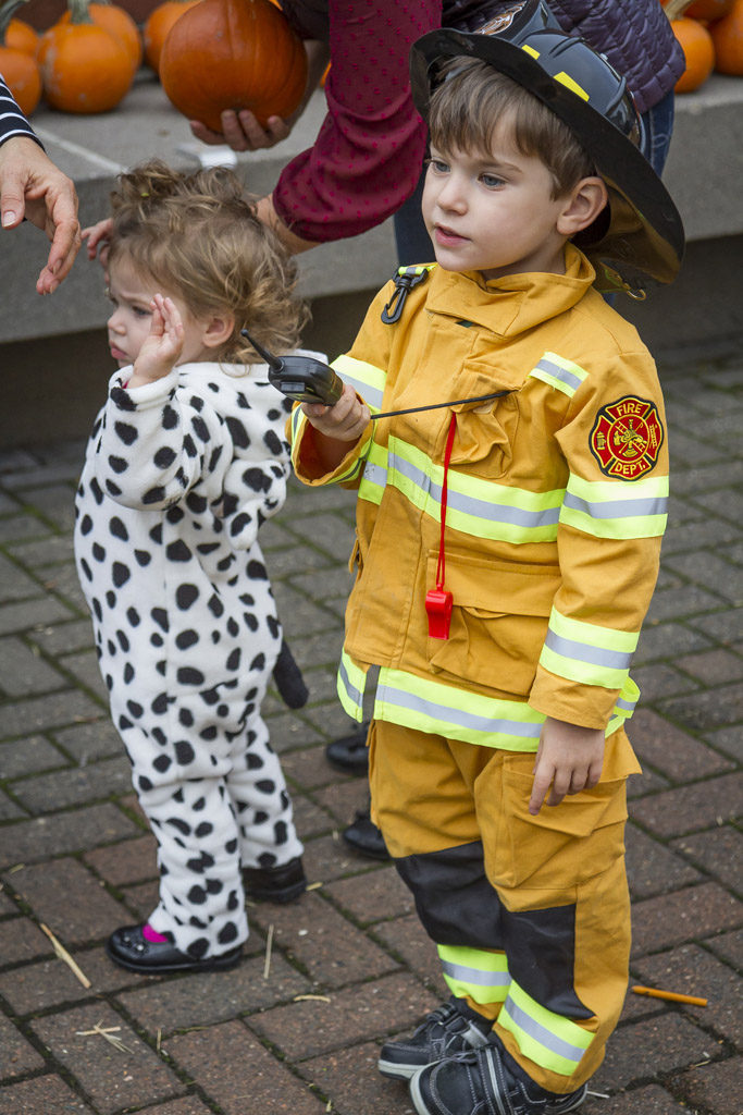 Every fireman (Caden Smith) deserves his own Dalmatian (Harper Smith), or at least it appeared that way Wednesday at the Downtown Washougal Pumpkin Harvest Festival. Photo by Mike Schultz