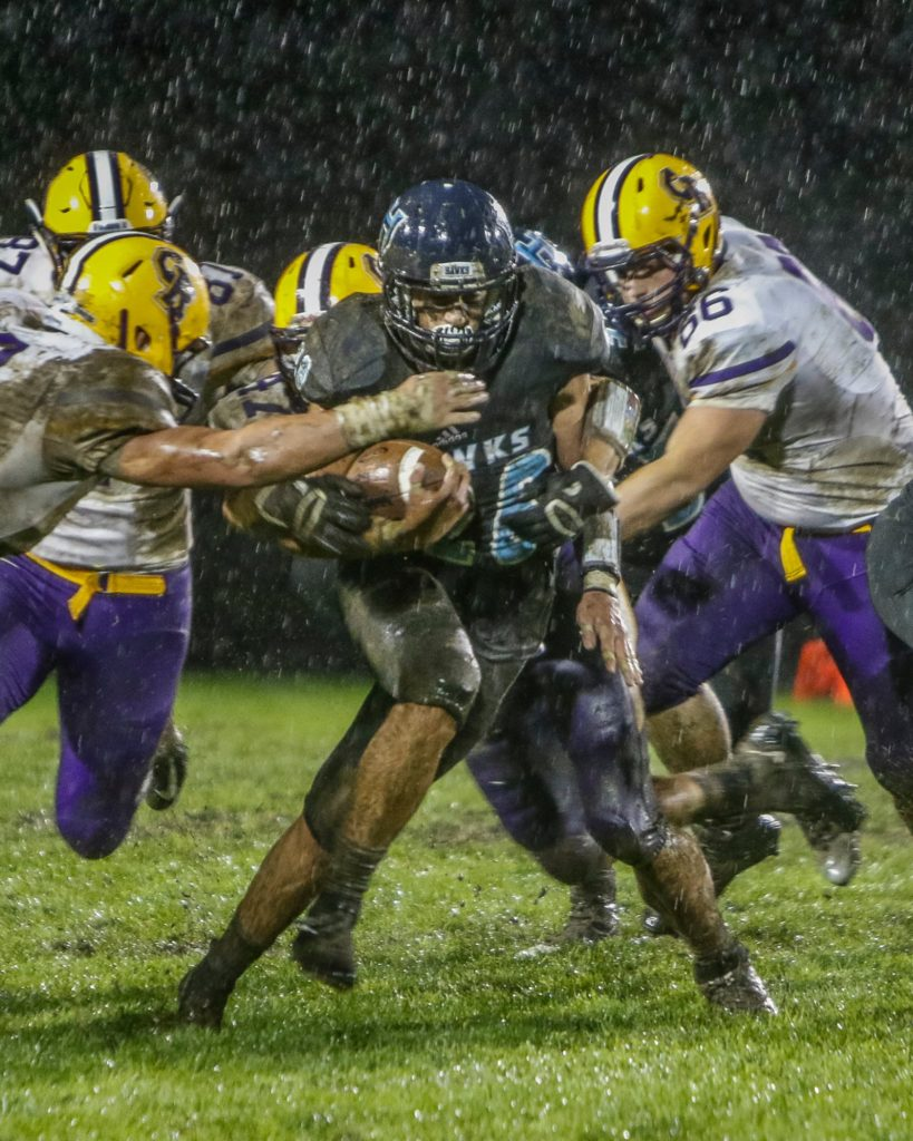 Hockinson running back Gannon Kytola (28) gains tough yardage against Columbia River. Photo by Mike Schultz