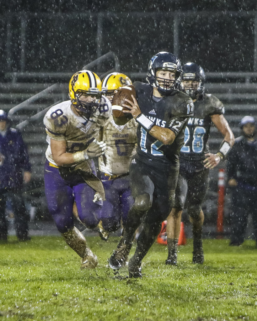 Hockinson quarterback Canon Raccanelli (12) has the Hawks in the driver's seat for the Greater St. Helens League Class 2A championship. Hockinson can wrap up the title with a win over R.A. Long next week. Photo by Mike Schultz