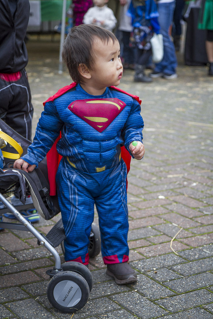 The mood was festive, so 17-month-old Jacob Witarsa didn't have to do anything too heroic Wednesday at the Downtown Washougal Pumpkin Harvest Festival. Photo by Mike Schultz