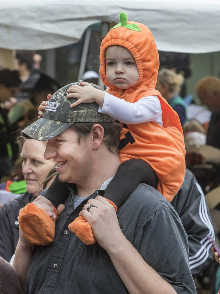 Jaxon Norton must have been thinking, 'why walk when I can ride' and Justin Norton was happy to oblige Wednesday at the Downtown Washougal Pumpkin Harvest Festival. Photo by Mike Schultz