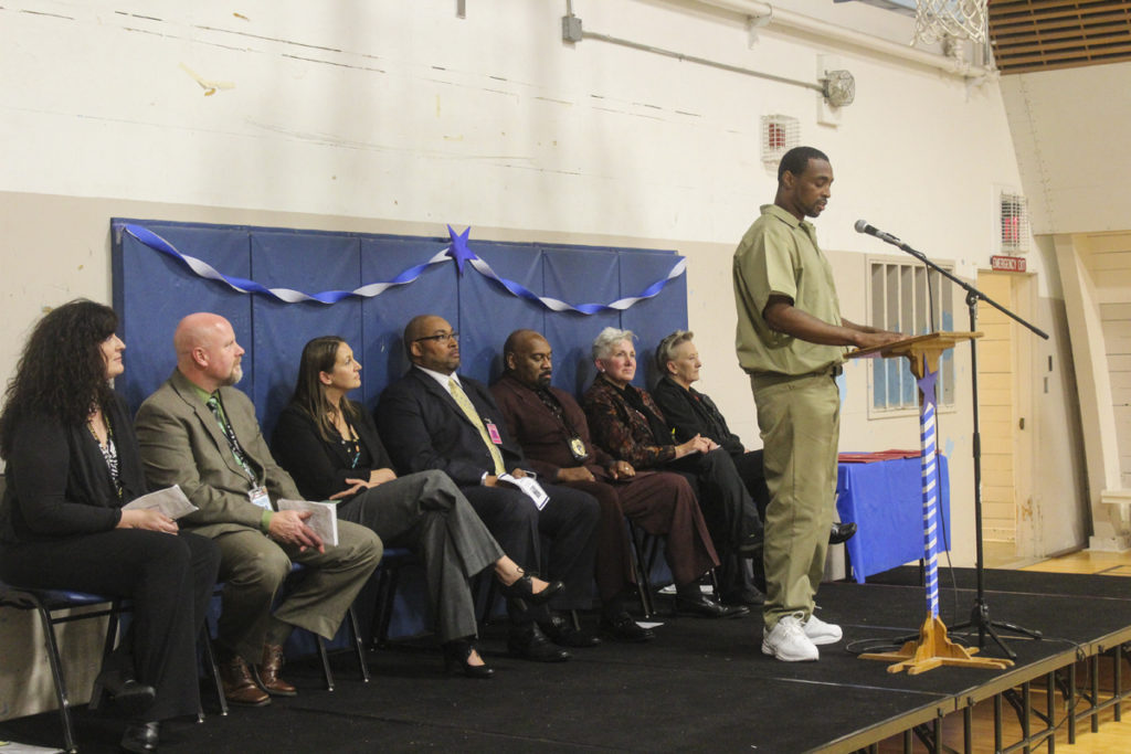 Several different inmates gave speeches on behalf of their different classes who were graduating from the Thinking for a Change program on Oct. 13 at Larch Corrections Center. Mario Clark gave the first speech, introducing his class, Class 21. Photo by Joanna Yorke