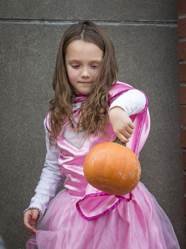 Makaylie Vandelden displays the pumpkin she received Wednesday at the Downtown Washougal Pumpkin Harvest Festival. Photo by Mike Schultz