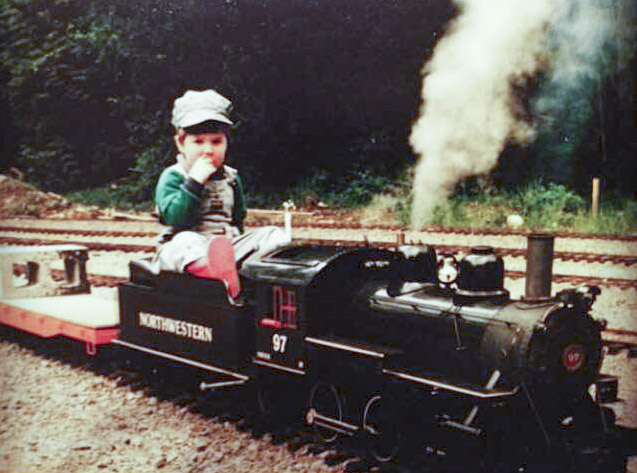 James Norvell, who owns and operates Norvell Railway with his partner, Kat Perri, is pictured here at the age of 4, riding on a miniature railway. Since he was a small boy, Norvell knew he wanted to have a miniature railway of his own someday. Photo courtesy of James Norvell and Kat Perri