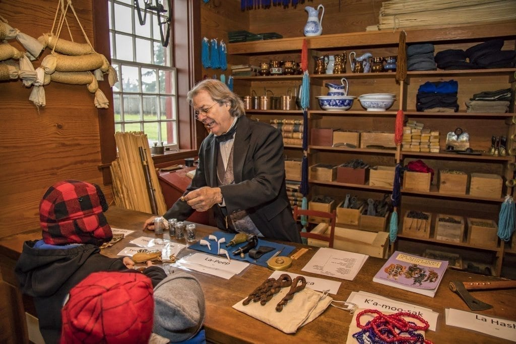 Ron Cronin educates some young visitors in the fur trade shop at the annual 'Christmas at Fort Vancouver' event Saturday at the Fort Vancouver National Historic site. Photo by Mike Schultz