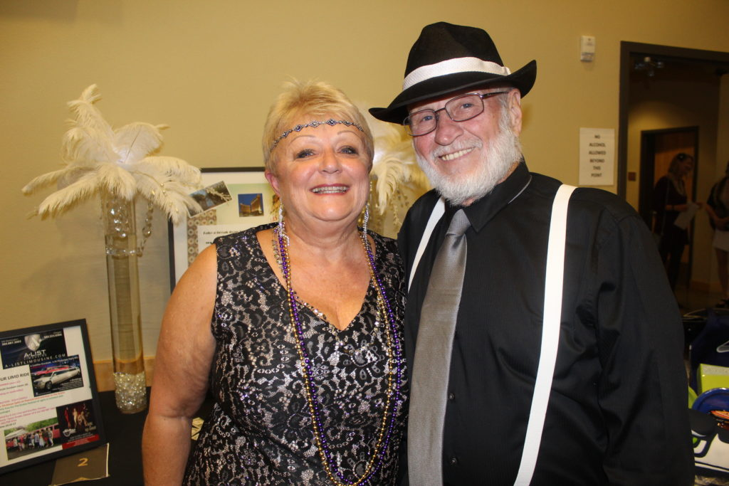Lynda and John Idsinga dressed in their finest 1920s threads to attend the annual North County Community Food Bank Scare Away Hunger dinner auction on Saturday evening. Photo by Joanna Yorke