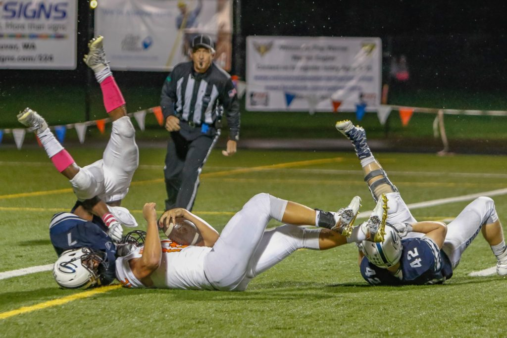 Skyview defenders Dyvon Green (7) and James Millspaugh (42) stop Battle Ground running back Curtis Stradley (12) short of the goal line. Photo by Mike Schultz.