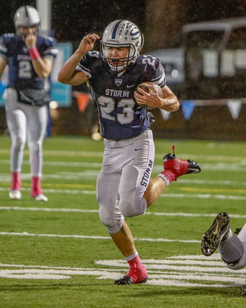 Skyview running back Hayden Froeber (23) high steps for yardage in a victory over Battle Ground. Photo by Mike Schultz.
