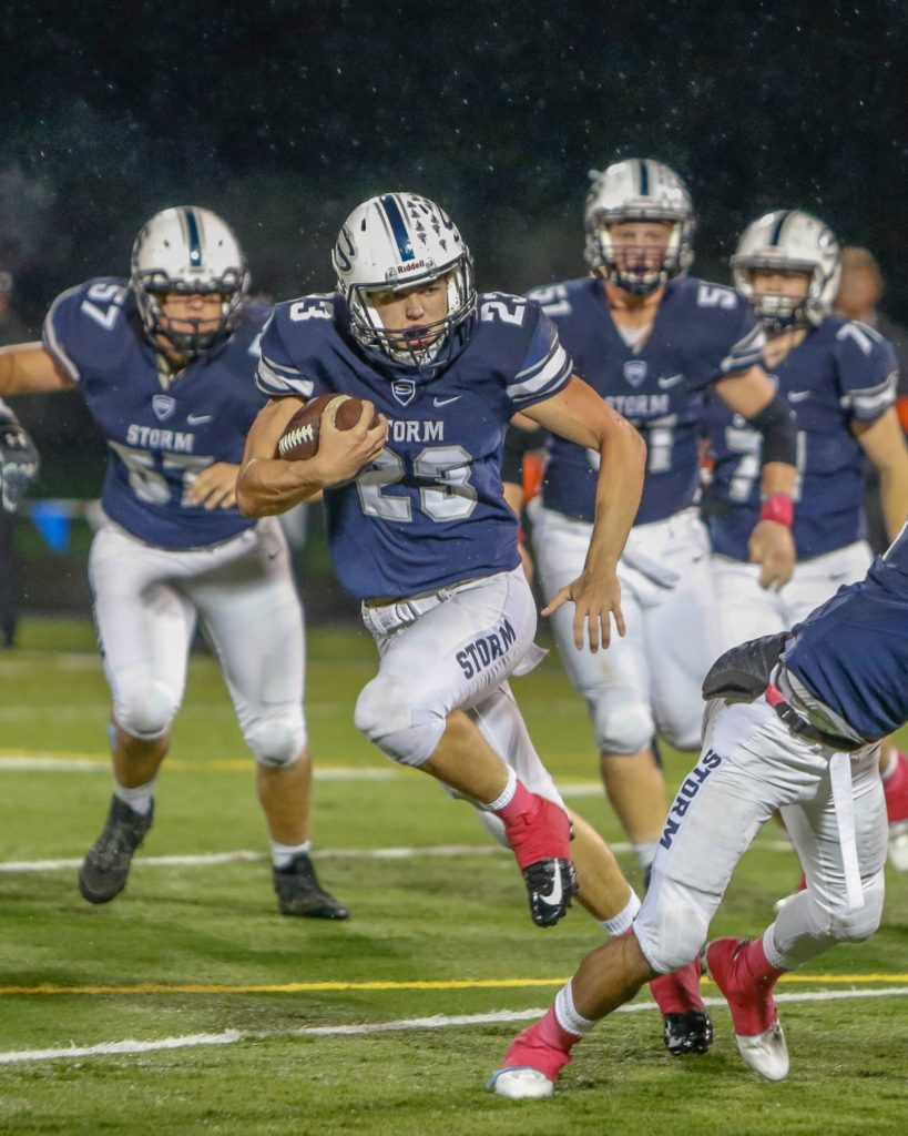 Skyview running back Hayden Froeber (23) runs for yards in a victory over Battle Ground Thursday at Kiggins Bowl. Photo by Mike Schultz.