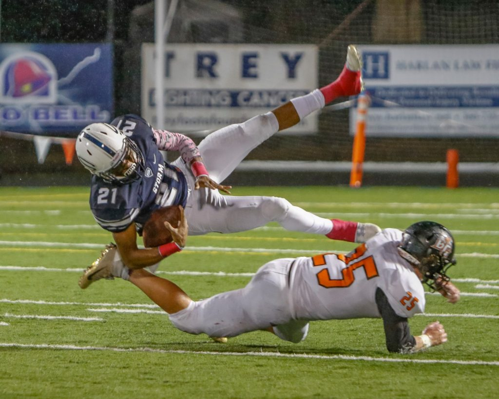 Skyview wide receiver Jeremiah Wright (21) is uphended by Battle Ground defensive back Max Randle (25). Photo by Mike Schultz.