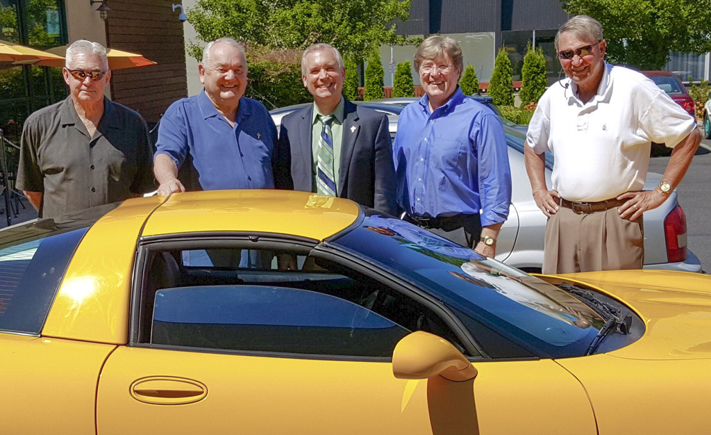Steve Runyan (second from left) is shown here with his prized 2000 Corvette after dining for lunch recently with friends and fellow car enthusiasts Dave Funk (far left), David Madore (center), Terry Phillips (second from right) and Dick Hannah (far right). Runyan passed away on Oct. 6 after complications, including pneumonia, followed an infection. Photo courtesy of David Madore.