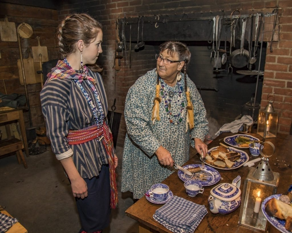 Sydney Jenkins and Sally Rothnacker-Peyton are shown here preparing food in the kitchen Saturday at the annual 'Christmas at Fort Vancouver' event at the Fort Vancouver National Historic site. Photo by Mike Schultz