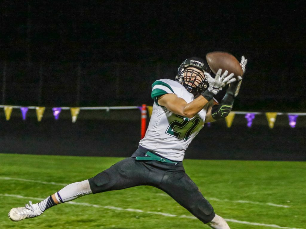 Woodland wide receiver Tyler Flanagan (21) catches a touchdown pass from quarterback Wyatt Harsh in the first quarter of Friday's game at Columbia River High School. Photo by Mike Schultz.