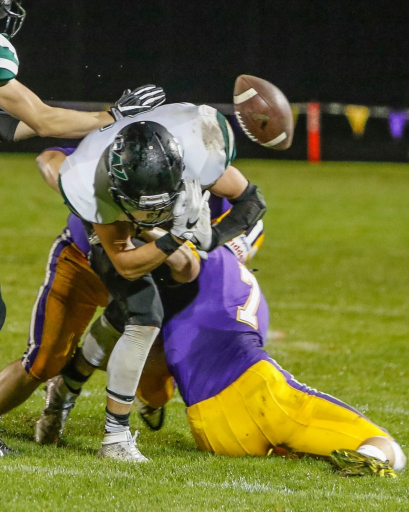 Woodland wide receiver Tyler Flanagan (21) fumbles after being hit by Columbia River defensive back Nathan Kunz (7). Flanagan recovered his own fumble. Photo by Mike Schultz.