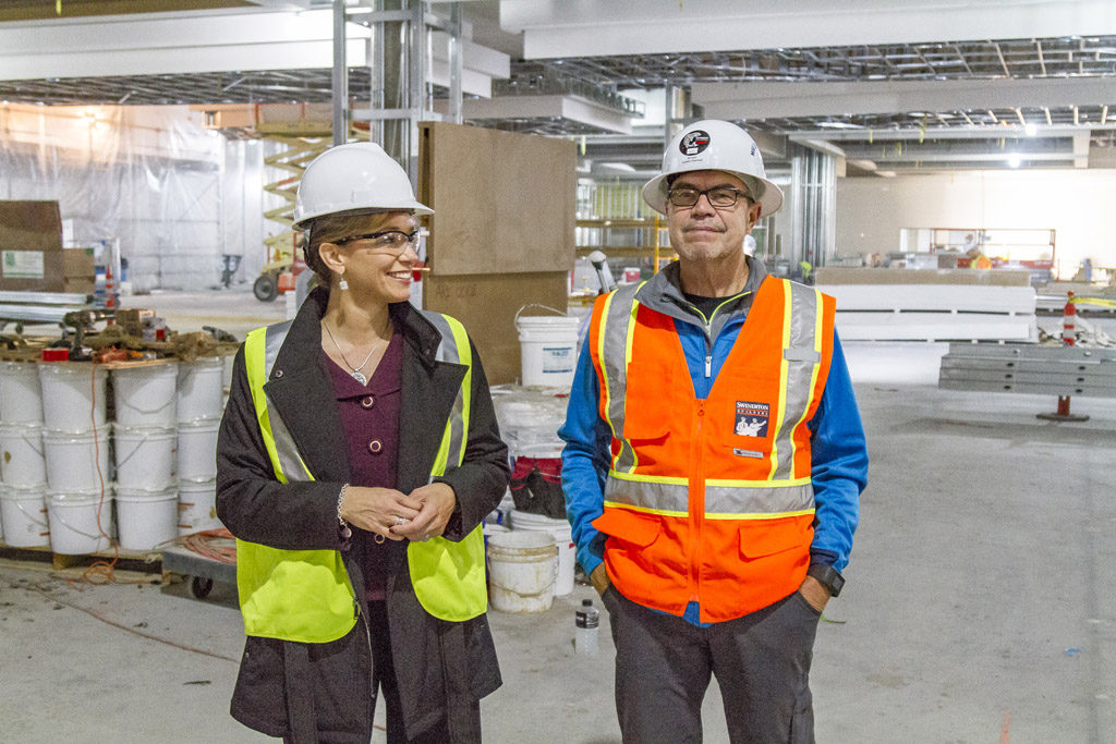 Kara Fox-LaRose (left), project manager of the ilani resort, and Cowlitz Indian Tribe Chairman Bill Iyall tour the construction site of the $510 million casino-resort being built on the Cowlitz Indian Reservation near La Center in north Clark County. Photo by Mike Schultz