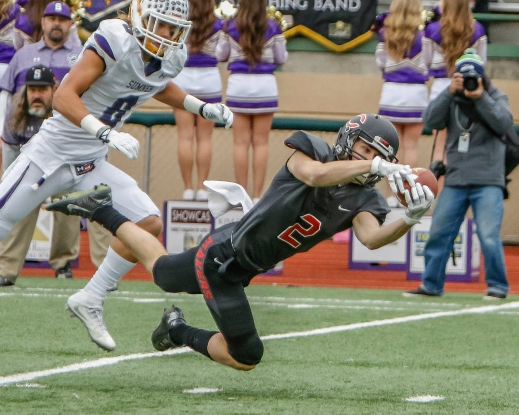 Camas wide receiver Ryan Rushall (2) reaches out for a catch against Sumner. Photo by Mike Schultz