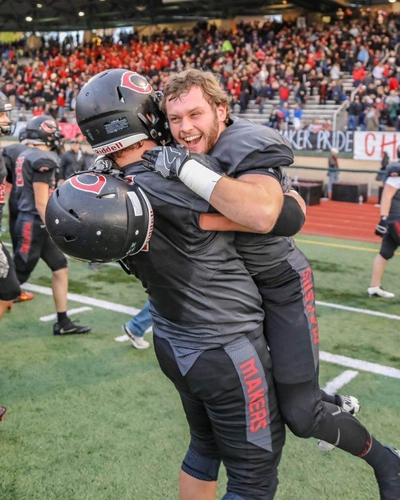 Camas offensive lineman Caleb Eldred celebrates with offensive lineman Vinny Gannaro after a victory over Sumner. Photo by Mike Schultz