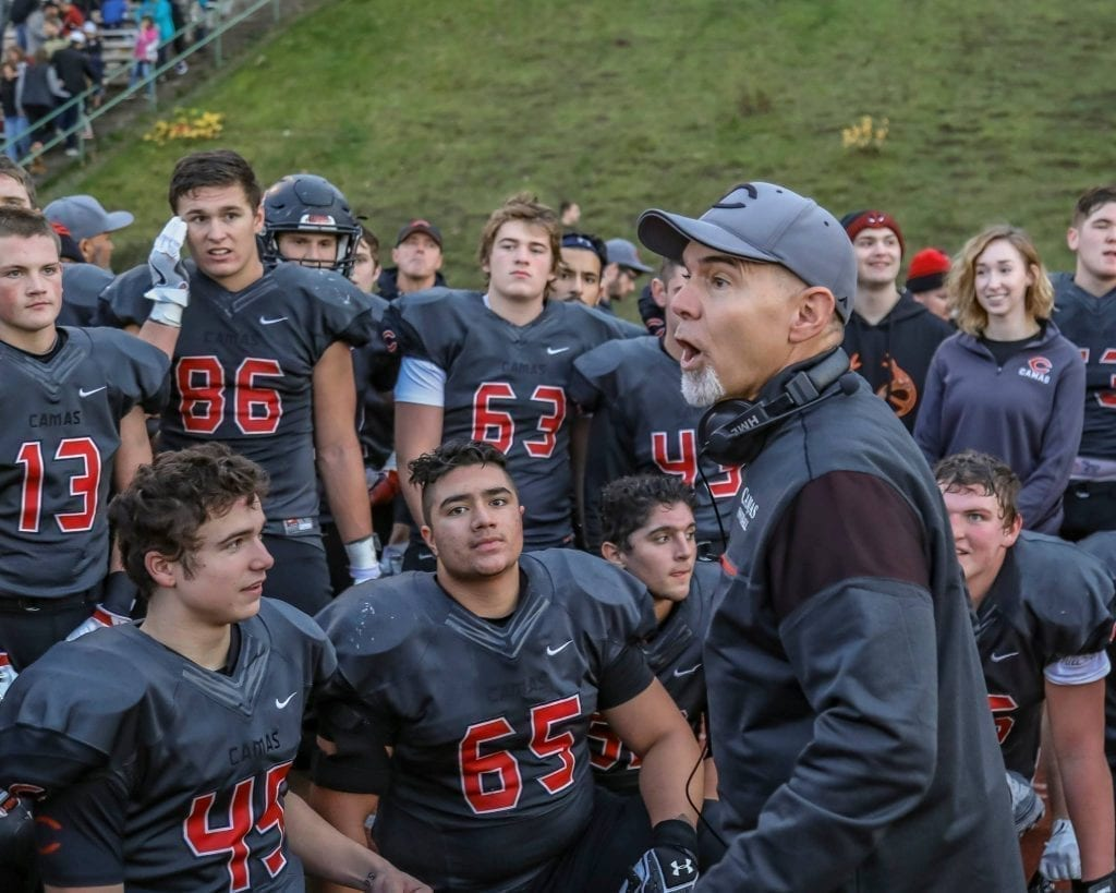 Camas head coach Jon Eagle speaks to the palyers after a victory over Sumner. Photo by Mike Schultz