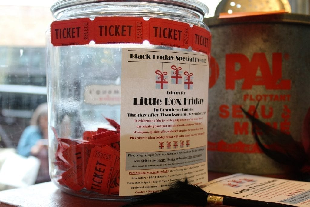 A raffle jar to collect raffle tickets for the Little Box Friday event in downtown Camas, is filling up at the Camas Antiques shop on Fri., Nov. 25. Photo by Kelly Moyer