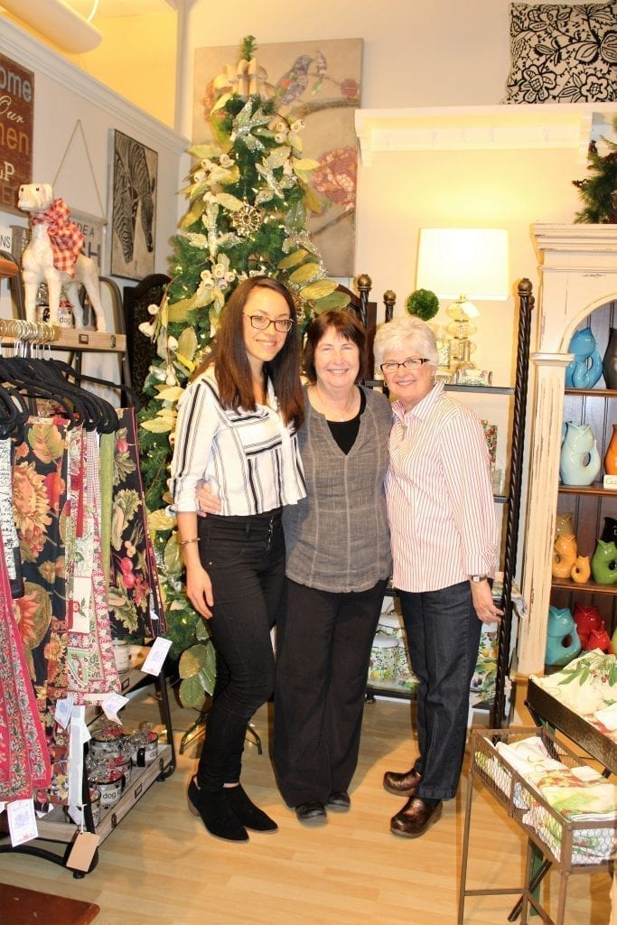 Beth Forsythe (center), the owner of Lizzabeth A, a home decor and furniture shop in downtown Camas, stands with her regular employee, Laura Gilbert (right) and temporary holiday employee, Marie Ongtooguk (left), during the Little Box Friday shopping event in downtown Camas, held 10 a.m. to 6 p.m., Fri., Nov. 25. Photo by Kelly Moyer