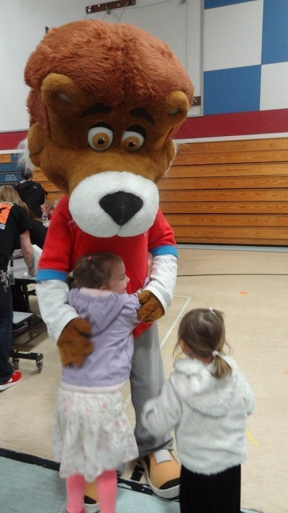 Chartwells character, Lionel the Lion, greets students during Ridgefield Schools' annual Thanksgiving lunch. Photo courtesy of Ridgefield School District