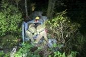 Vehicle goes over embankment near Moulton Falls Park