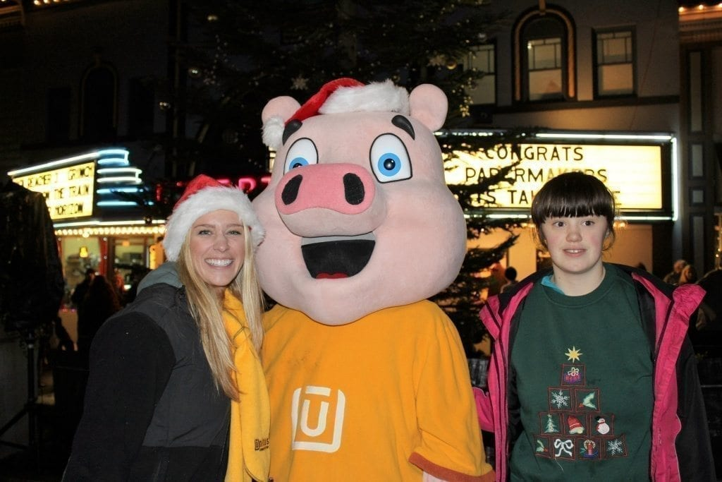 Tiffany Wooden, a teen from Troutdale (right) stops to meet Hamilton, the mascot of Unitus Credit Union, and Natalie Cook (left), a Unitus employee, at the annual Camas Hometown Holidays festival on Fri., Dec. 2, in downtown Camas. Unitus was one of the event sponsors for this year's holiday celebration. Photo by Kelly Moyer