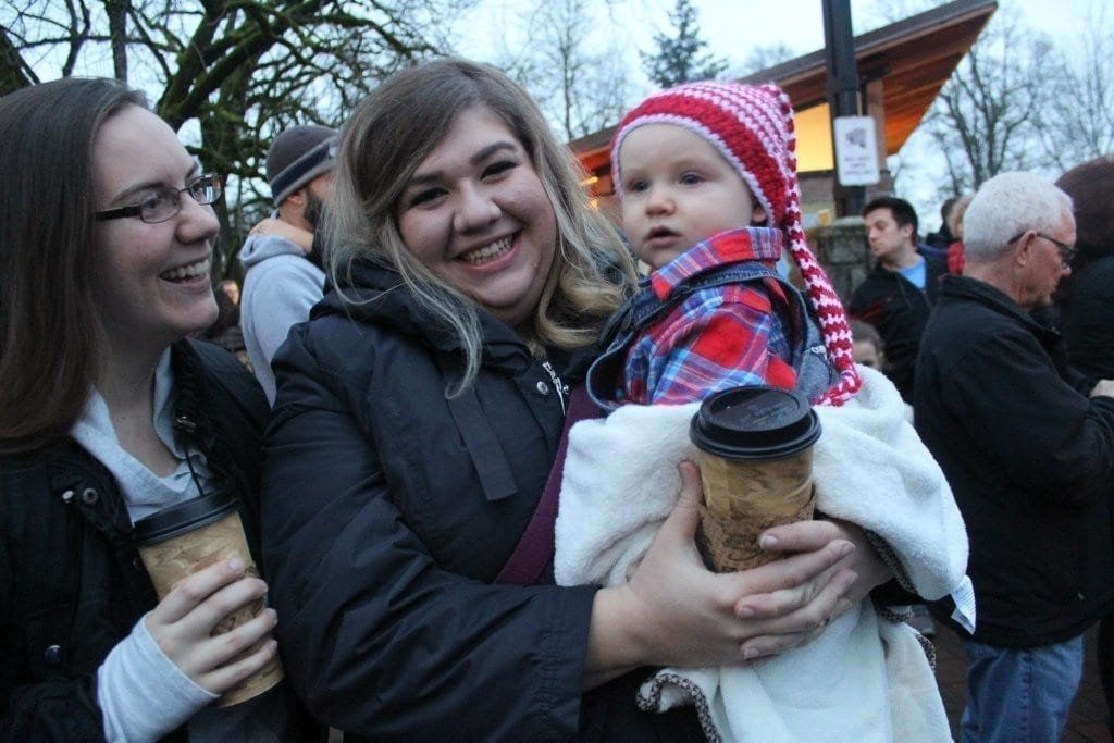 Eight-month-old Nash Naumann, of Ridgefield, wore an appropriately holiday themed hat when he attended Ridgefield's annual Christmas Tree Lighting Festival Saturday evening with his mom, Sydney Naumann (left) and Elizabeth La Valle (right).  Photo by Joanna Yorke