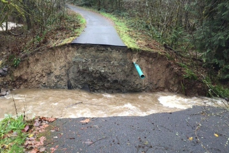 Twelve households in La Center's Timber Creek Estates subdivision had to pay more than $200,000 to rebuild washed-out, private road