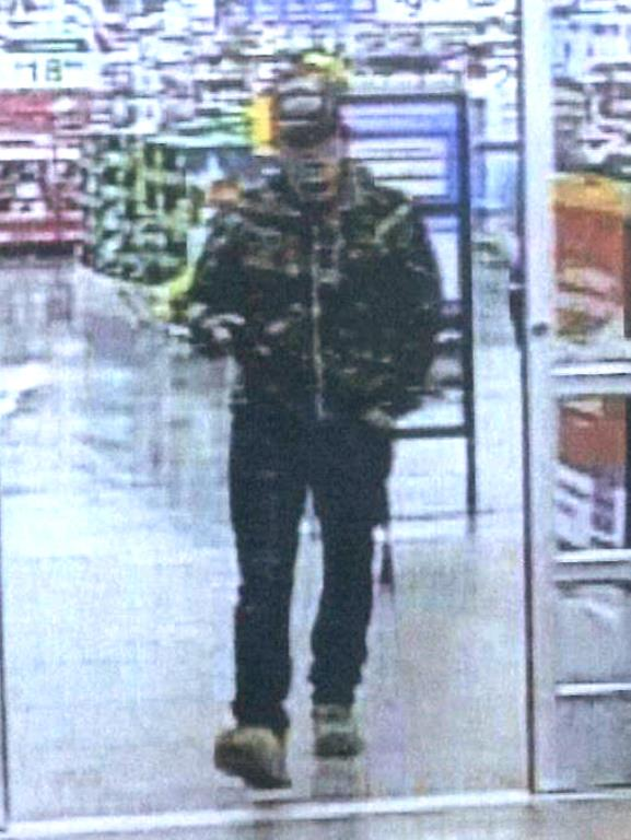 Battle Ground Police are asking for the public's help in identifying this suspect who is accused of taking pictures of a female through a gap in a stall door in the women's restroom in the Battle Ground Walmart. Photo courtesy of the city of Battle Ground
