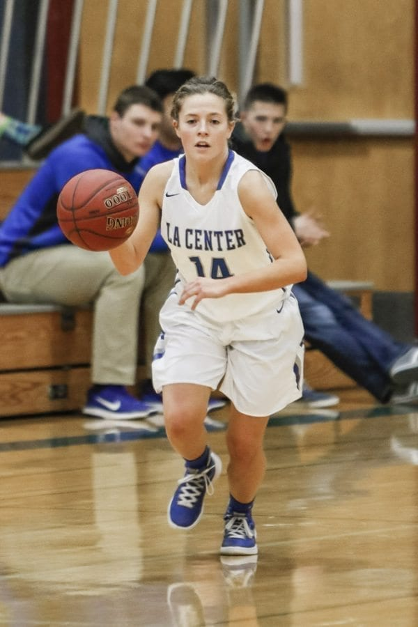 Junior guard Bethany Whitten (14) is one of La Center's two co-captains this season. She displays her leadership on both offense and defense and has helped La Center amass a 13-0 record this season. Photo by Mike Schultz