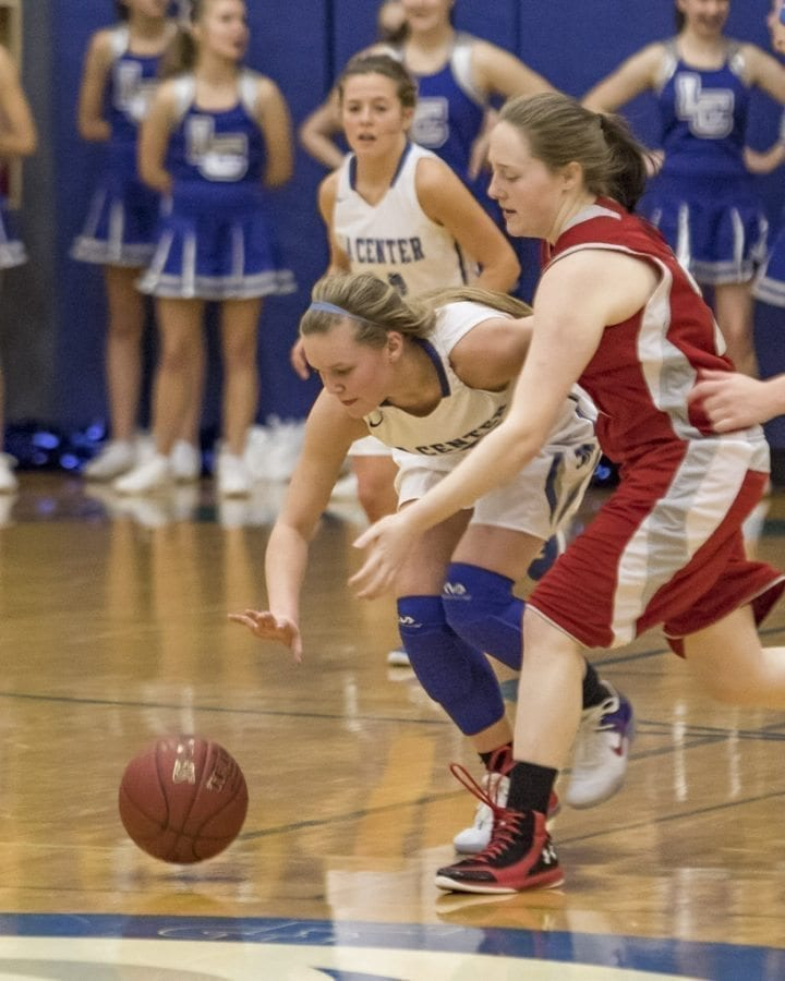 Junior guard Molly Edwards (10) is shown here fighting for possession of the basketball in a recent victory over Castle Rock. Edwards is averaging 12.7 points per game this season. Photo by Mike Schultz