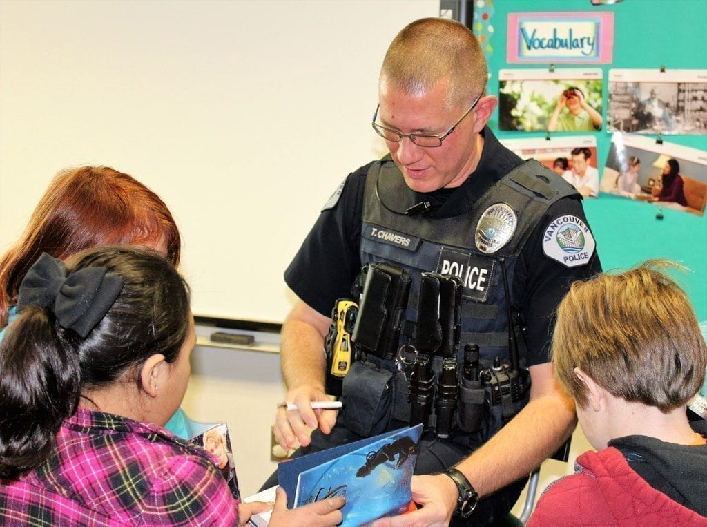 Vancouver Police Activities League, police officers share love of reading, stress gun safety with local third-graders