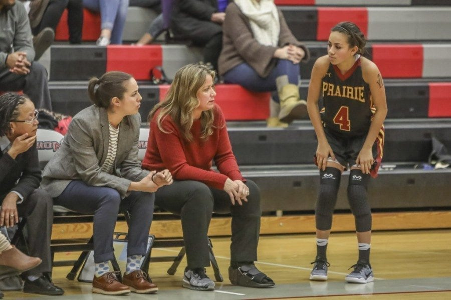 Hala Corral (red shirt) took over as the head coach of the Prairie High School girls basketball team this season. Hala has received help from former Prairie standout and daughter Ashley Corral (pictured to Hala's right). Daughter Allie Corral (4) is a freshman on this year's Prairie team. Photo by Mike Schultz