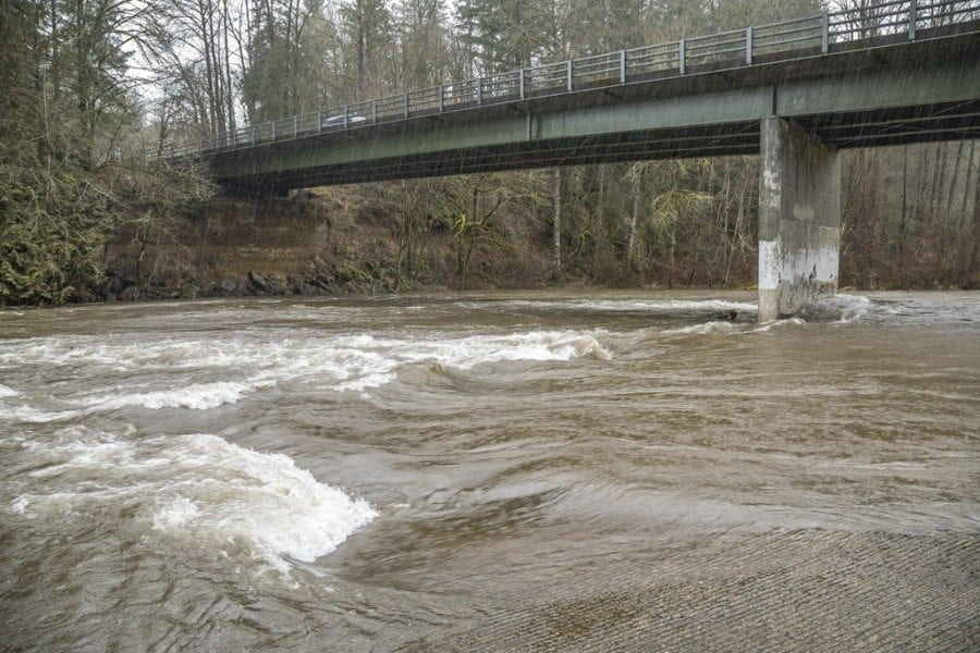 Rains and higher temperatures led to flood warnings around Clark County. This photo shows the East Fork Lewis River near Daybreak Park in Battle Ground on Thursday. Photo by Mike Schultz