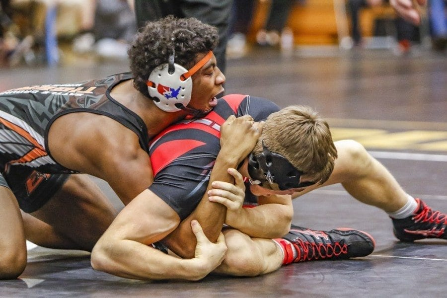 Five area wrestlers claimed state individual wrestling titles at the Mat Classic state tournament at the Tacoma Dome Saturday.