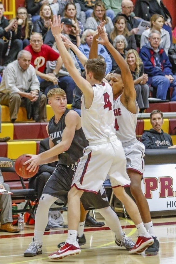 Prairie defeated Peninsula 56-44 in the first round of the Class 3A boys bi-district tournament in a game played at Prairie High School. The Falcons advance to play Timberline on Friday.