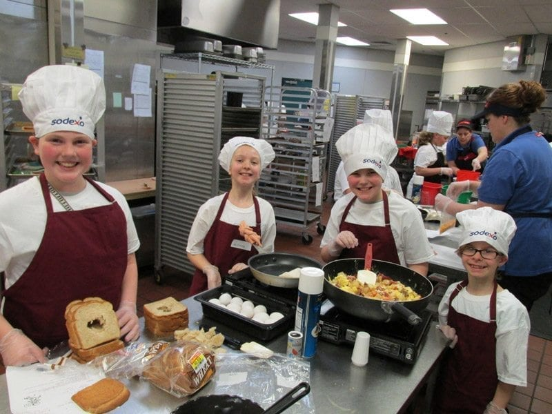 Battle Ground Public Schools' students in last year's Sodexo Future Chefs Challenge are shown here preparing their submissions. Photo courtesy of Battle Ground Public Schools