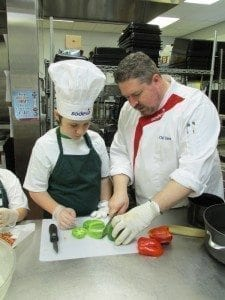 A Battle Ground Public Schools' student prepares ingredients with help from Chef Dave from Sodexo. Photo courtesy of Battle Ground Public Schools