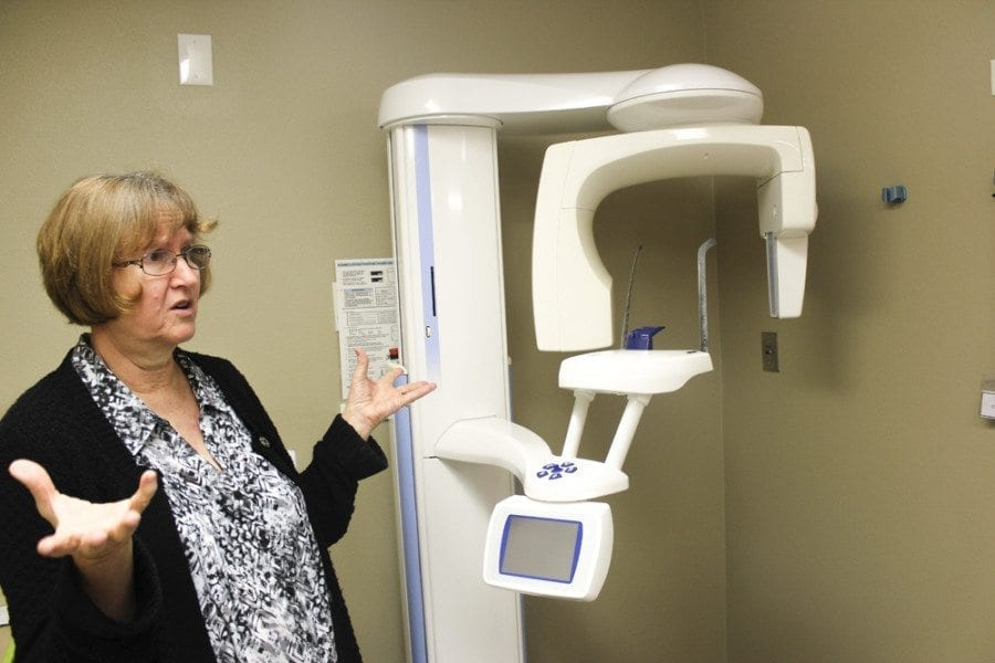 Ruthie Gohl of Battle Ground Health Care talks about the panoramic dental X-ray machine that they are now able to use as a part of the dental services offered at the Battle Ground Health Care clinic. Photo by Joanna Yorke