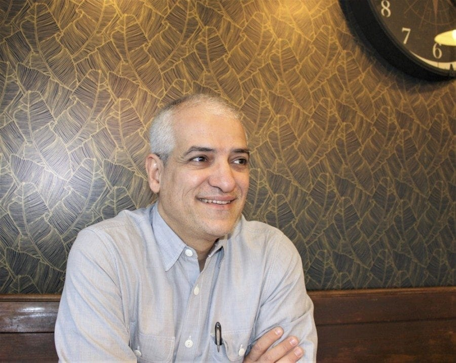 Dr. Mehrdad Shojaei, a hospitalist at the Legacy Salmon Creek Medical Center, reflects on his use of fine art photography to help heal patients and even complete strangers, at the Compass Coffee Roasting in downtown Vancouver on Fri., March 3. Photo by Kelly Moyer