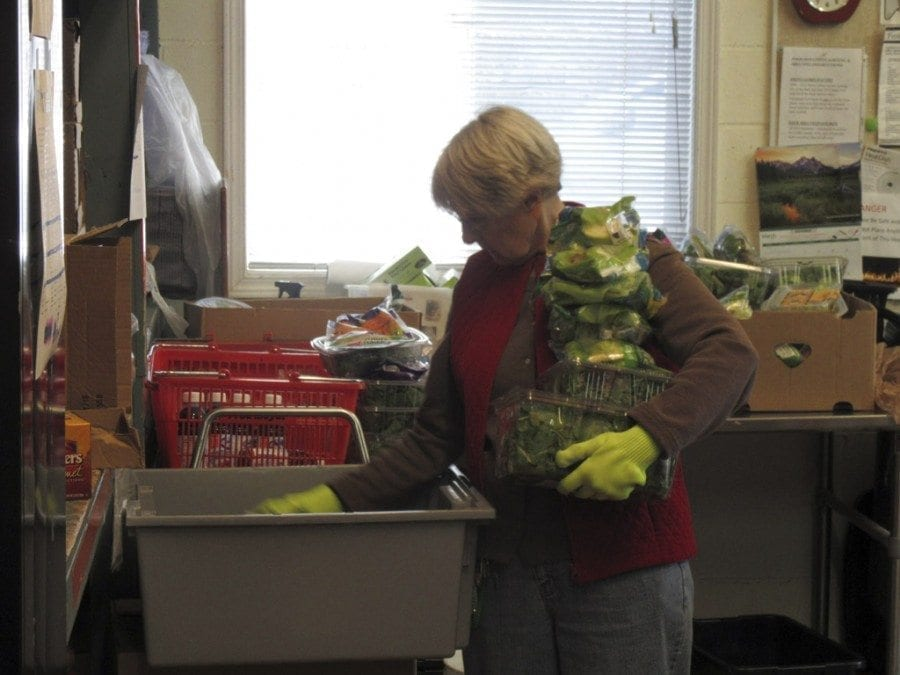 Pat Jeschke's work at the North County Community Food Bank includes rotating produce and other perishable items to ensure that clients receive fresh food. Photo courtesy of Carolyn Schultz-Rathbun