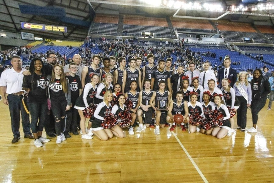 The Union High School boys basketball team finished second at the 2017 Class 4A state basketball tournament. The Titans, who finished fourth last year and third in 2015, earned a trophy for the third straight season. Photo by Mike Schultz